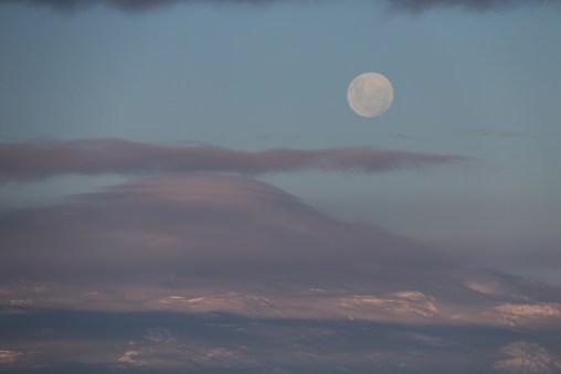 A massive full moon shines above Mt. Terror. © A. Padilla