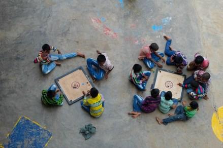Playing Carrom Board