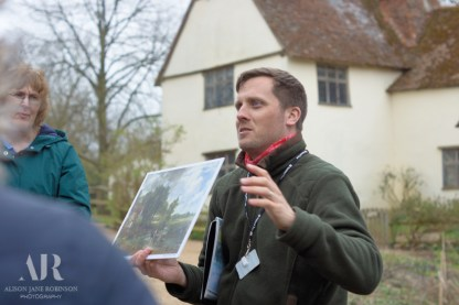 Talking about the Hay Wain in front of Willy Lott's Cottage