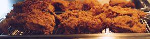 fried chicken on a heat tray