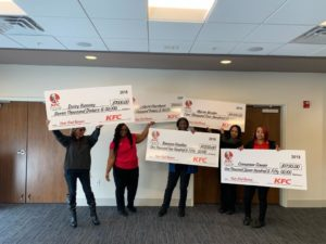 five women receiving their KFC end of the year bonuses