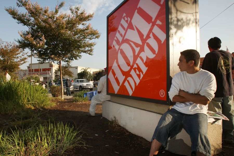 day laborers await work outside a Home Depot