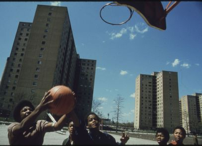 Youth playing basketball outside of the Stateway Gardens Highrise Housing Project. May 1973. Photo by John H. White.