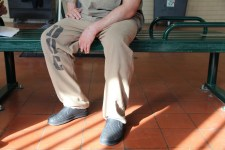 An inmate at Cook County Jaill, shown from the waist down in his uniform