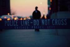 "A Chicago police barricade reading ""Police Line - Do Not Cross"""