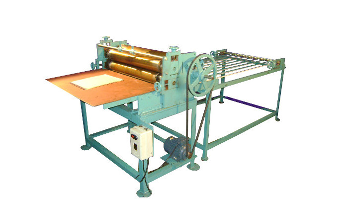 Top side gluing machine