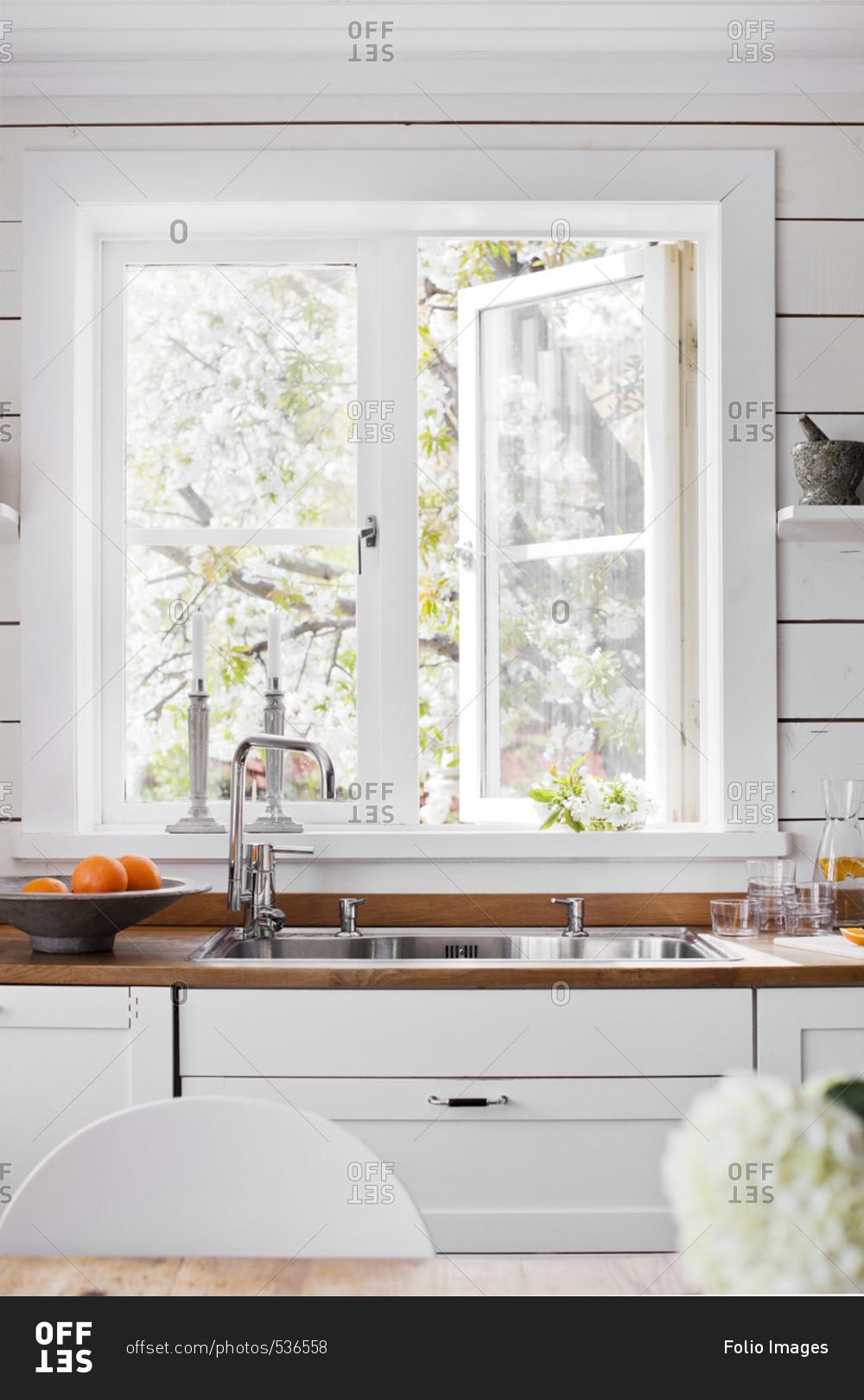 sweden sink by white window in