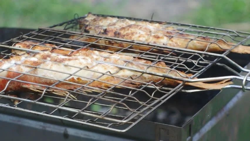 rock fish on the grill stock footage video 100 royalty free 4638854 shutterstock