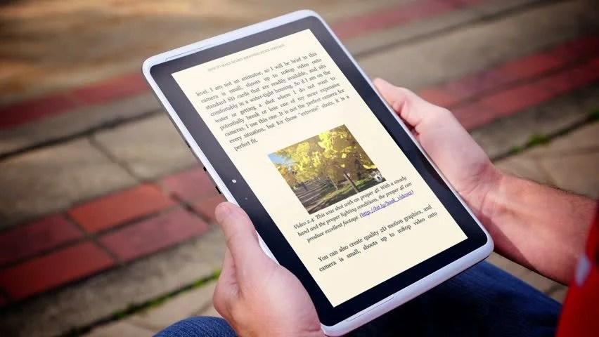 A Man Reads an Ebook Stock Footage Video (100% Royalty-free) 4673726    Shutterstock