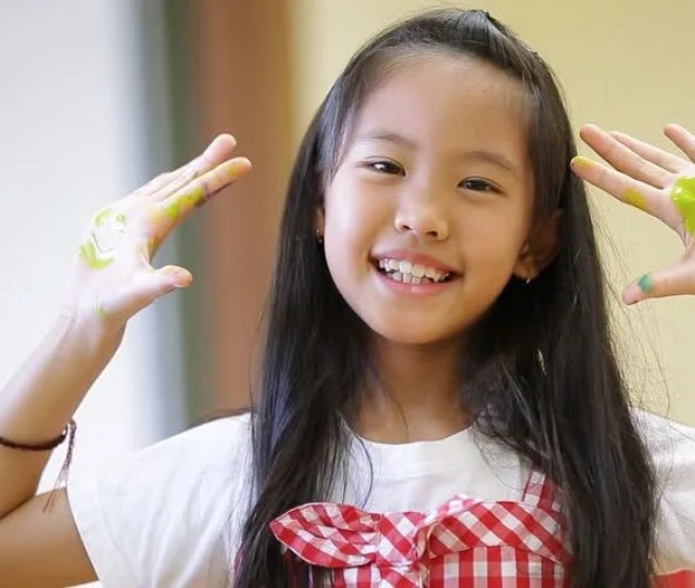 Little Asian Girl With Painted Palms