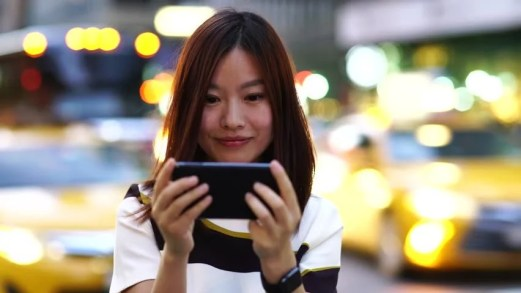 Image result for asian woman using phone