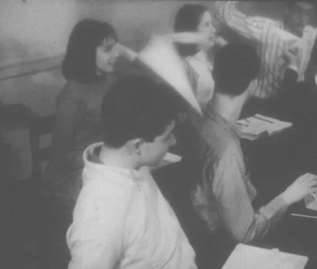 1960s United States Students Throw Paper Planes In Class Girl Sits At Desk