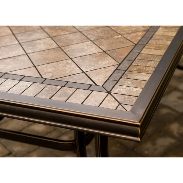 cast dining chairs tile top table