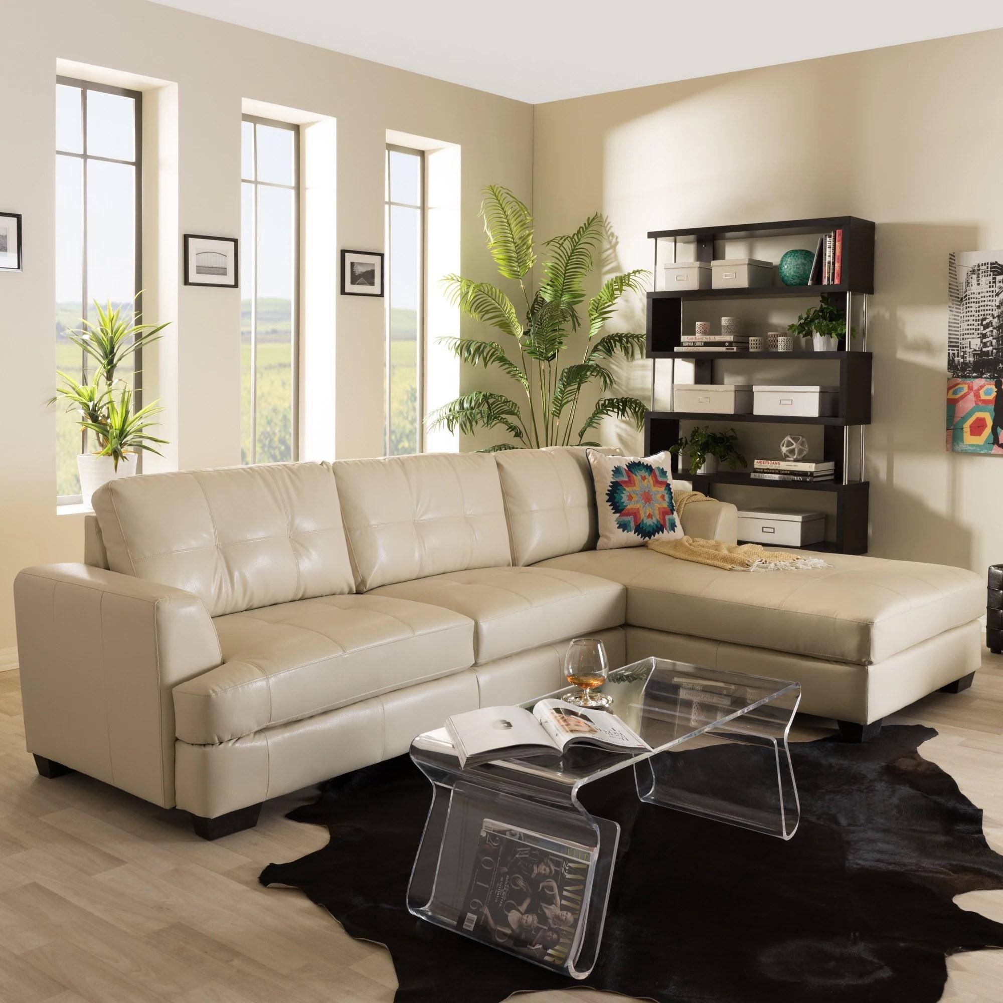 baxton studio dobson modern cream bonded leather tufted sectional sofa