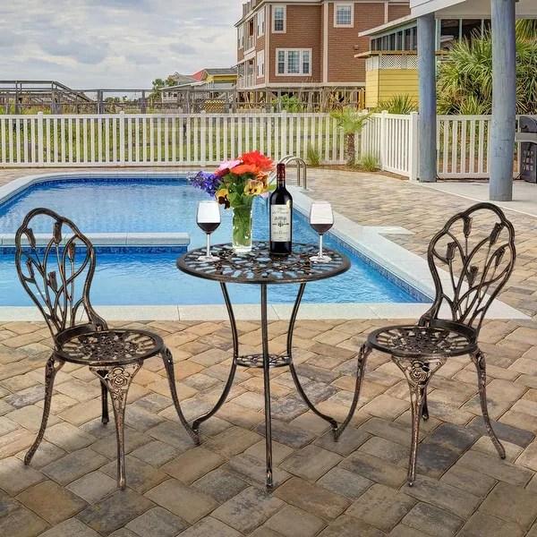 https www overstock com home garden 3 piece cast aluminum patio bistro set outdoor furniture tulip design antique copper finish rust resistant 28269002 product html