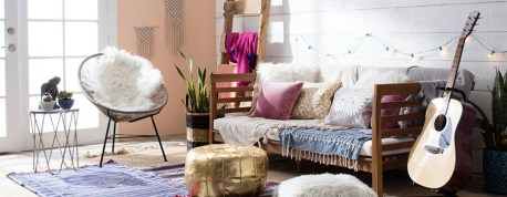Boho Chic-styled living room with floor pillows, string lights, and a guitar