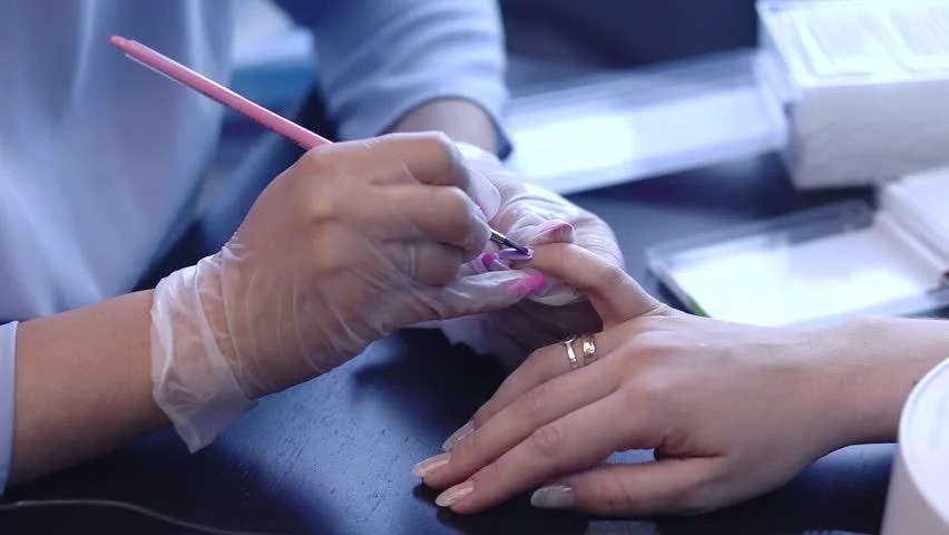 Manicurist Treats Nails Closeup Shot Hd Stock Clip