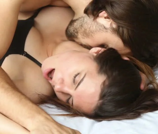 Sensual Lovers Making Love In Bed Passionate Woman Enjoying Pleasant Sensation While Man Kissing Her