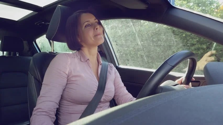 Happy Beautiful Woman 30s With Short Hair Driving Car Singing