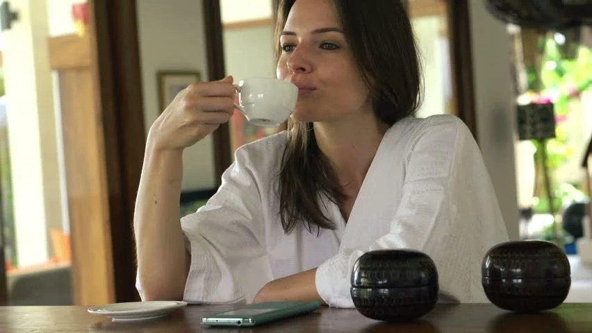Beautiful Woman With Smartphone Drinking Stock Footage