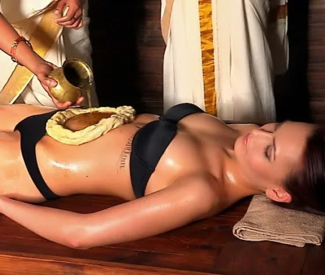 Young Woman Having Stomach Ayurveda Spa Treatment Massage Abdomen Using Pouring Oil In Form Of Dough Camera Moving Forward