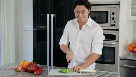 An Attractive Home Chef Standing In The Kitchen Chopping Salad For A Great Healthy Meal