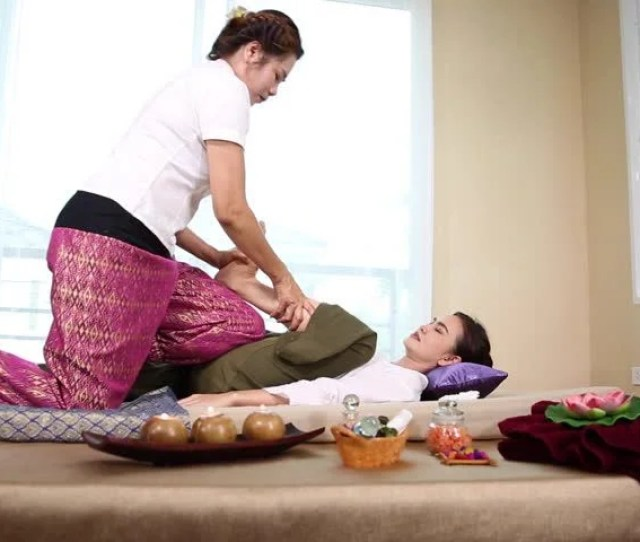 Young Woman Getting Thai Body Massage In Spa Room