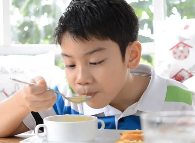 Image result for child drinking soup