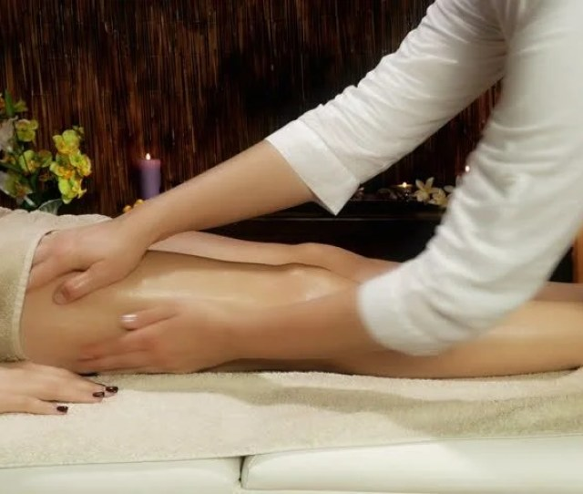 Closeup Of Female Legs Getting Massage In Luxury Spa