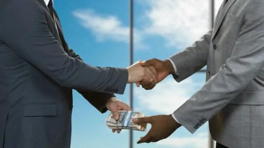 Image result for images of men shaking hands on a deal