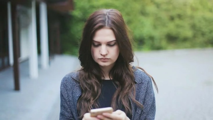 Image result for sad person holding mobile
