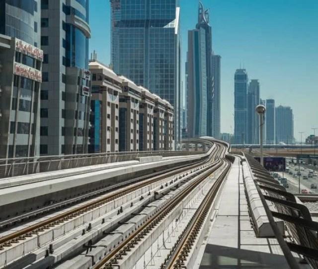 Dubai Uae May  Dubai Metro Train Move Away Along Elevated Railway