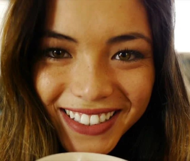 Beautiful Asian Teen Girl Sips Hot Chocolate Smiles Slow Motion