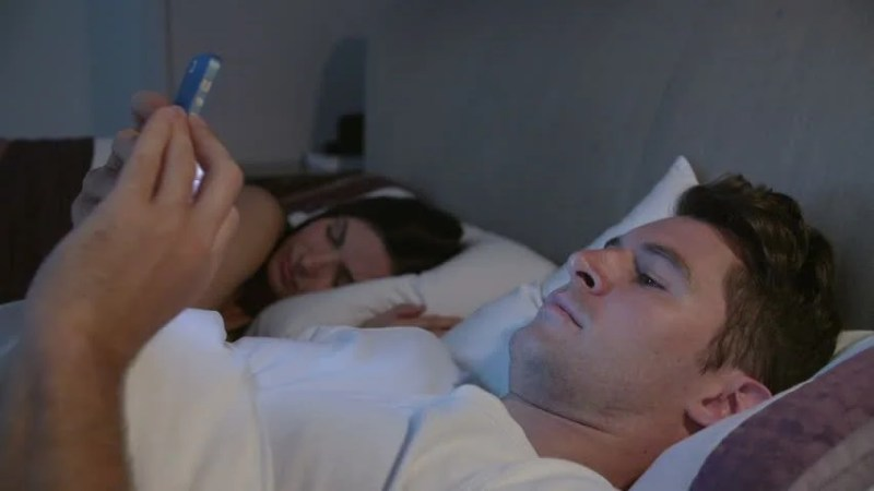 Image result for man with phone in bed