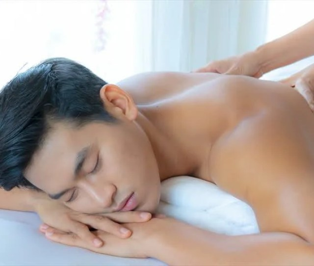 Young Asian Man Happiness With Receiving A Massage Theraphy In Luxury Spa Treatment Shop Popular Relaxation Lifestyle In Modern City Tourism Industry Use