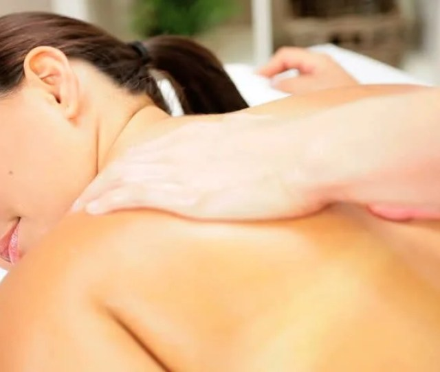 Beautiful Female Client Enjoying Upper Body Massage Therapy At A Luxury Health Spa
