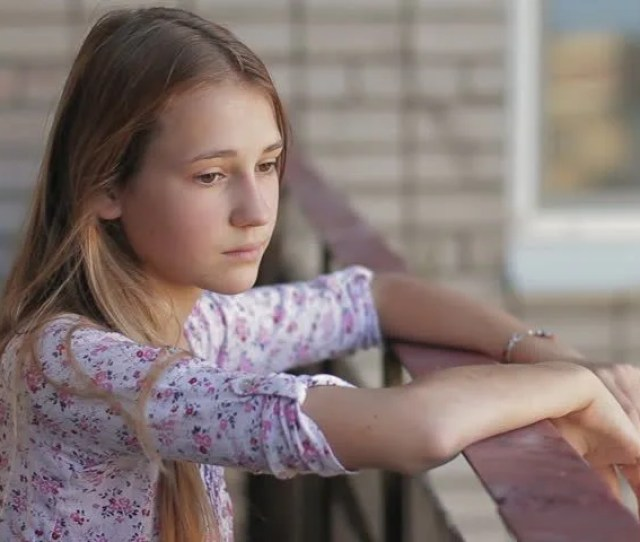 Teen Depression Pensive Young Girl Standing Alone On Balcony