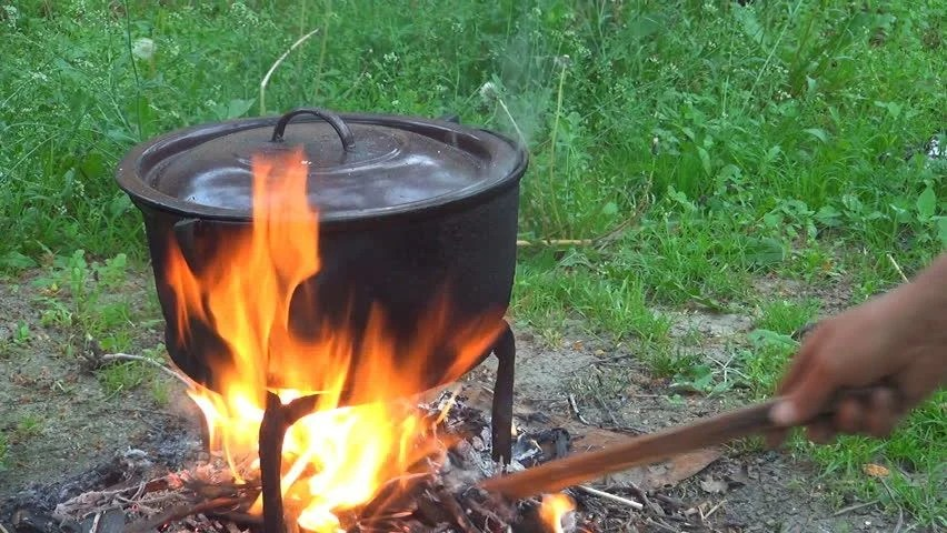 Rustic Pot Boiling Outdoor On A Fire In Yard Rural