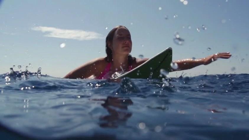 Image result for surfer paddling out
