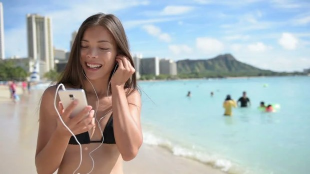Image result for listening music in earphones on the beach