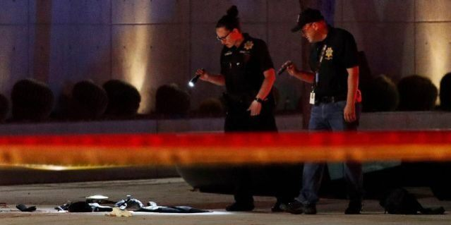 Investigators look at the scene of an officer involved shooting in front of a federal courthouse after a Black Lives Matter protest Tuesday, June 2, 2020, in Las Vegas. Protests continue over the death of George Floyd, who died after being restrained by Minneapolis police officers on May 25. (Associated Press)