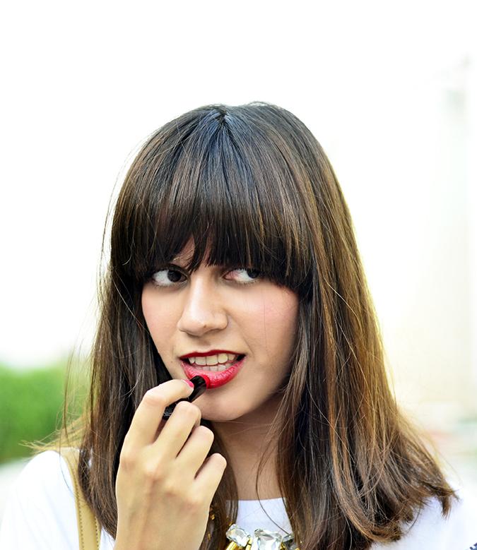 Summer Beauty Essentials | www.akanksharedhu.com | applying lipstick