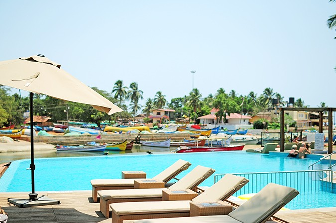 Acron Waterfront Resort | Goa | Akanksha Redhu | beds with pool at back