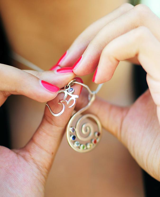Basic Vibes | Akanksha Redhu | holding pendants in fingers