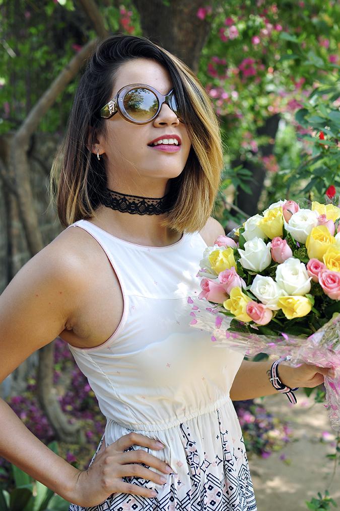 Sbuys | Akanksha Redhu | half front holding flowers
