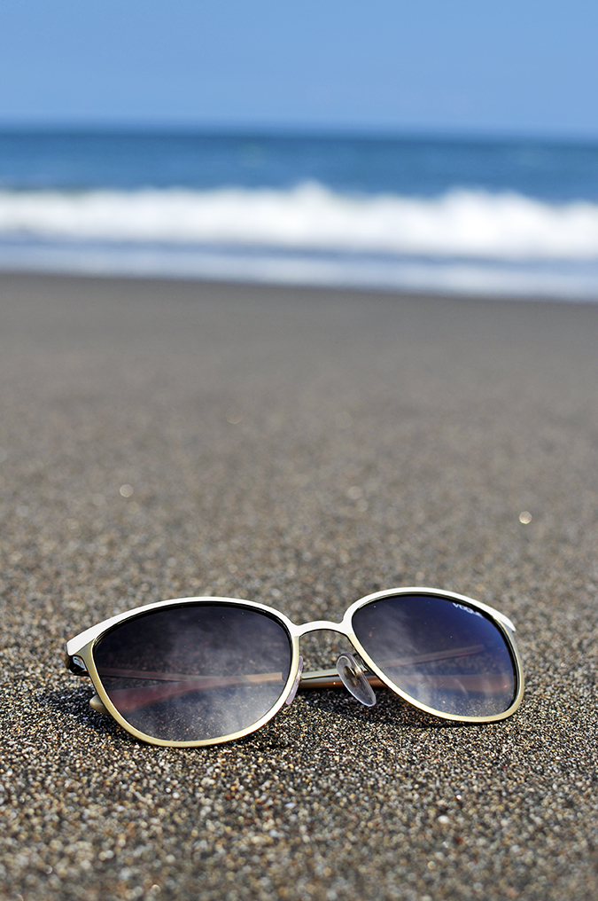 Soka Beach Bali | Akanksha Redhu | sunglasses on balian sand