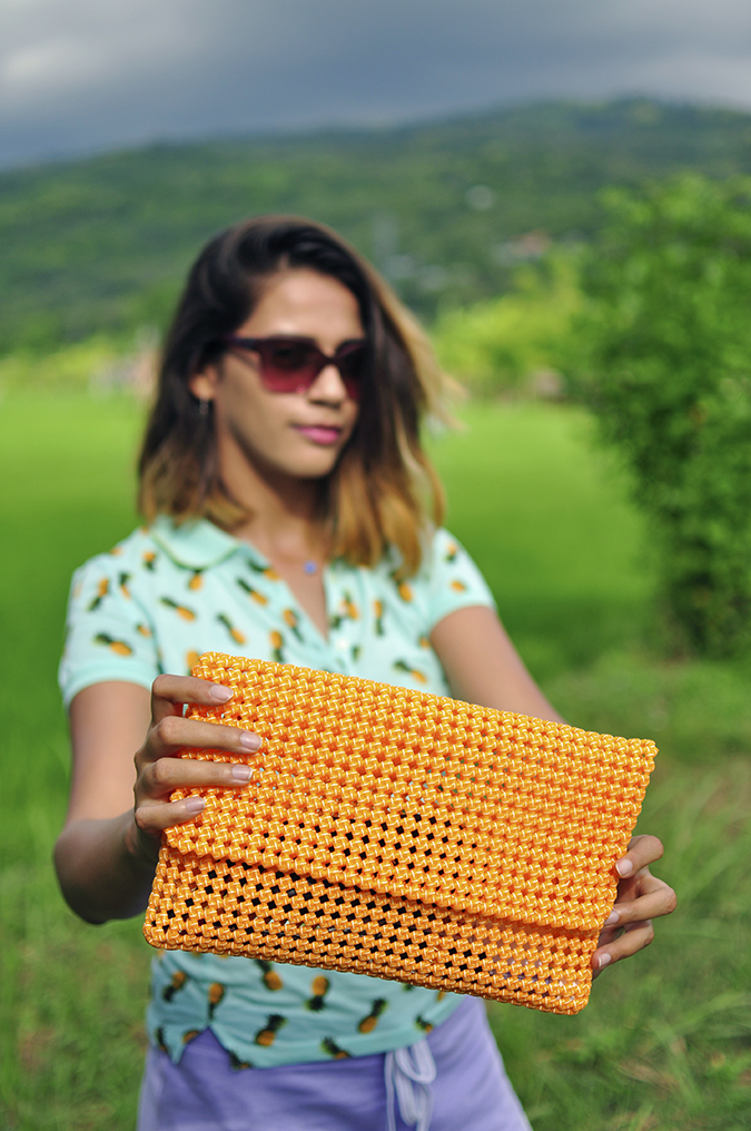 Bali Life | Amazon India | Akanksha Redhu | holding clutch in front