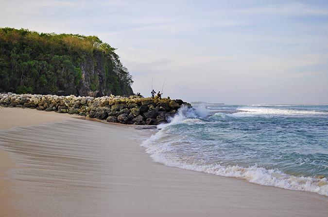 Nikkos Beach   Bali   Akanksha Redhu   wide fishermen rock