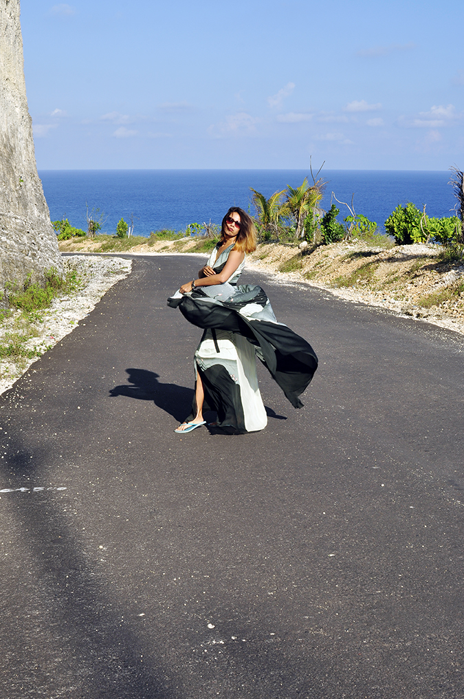 Pantai Melasti   Bali   Akanksha Redhu   full side road fly far slippers