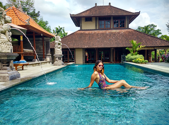 Ubud | Akanksha Redhu | sitting in pool phone wide
